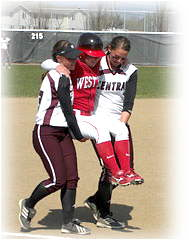 Sara Tocholsky is carried around the bases by the opposing team.